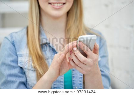 people, technology and internet concept - close up of teenage girl hands with smartphone