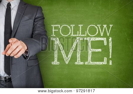 Follow me on blackboard with businessman