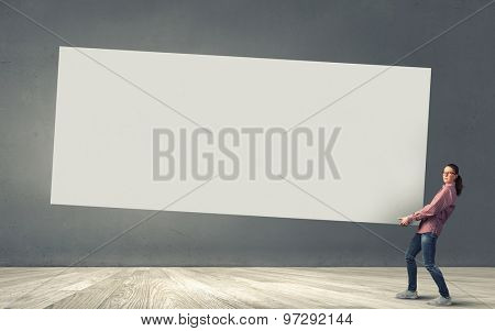 Young girl carrying white blank banner place for text