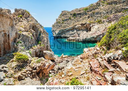 Wild Beach With Rocks And Turquoise Water.