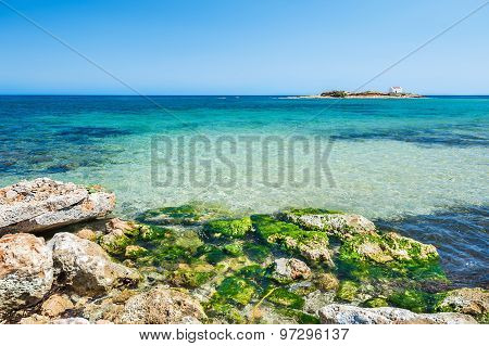 Beautiful Beach With Turquoise Water And Stones