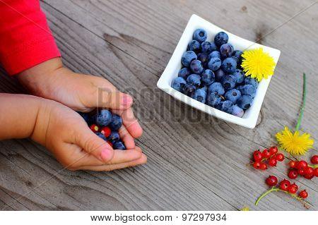Fresh Fruit In Little Children´s Hand