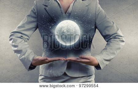 Close up of businesswoman holding in hands full moon