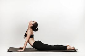 stock photo of yoga  - Young fit woman at yoga class - JPG