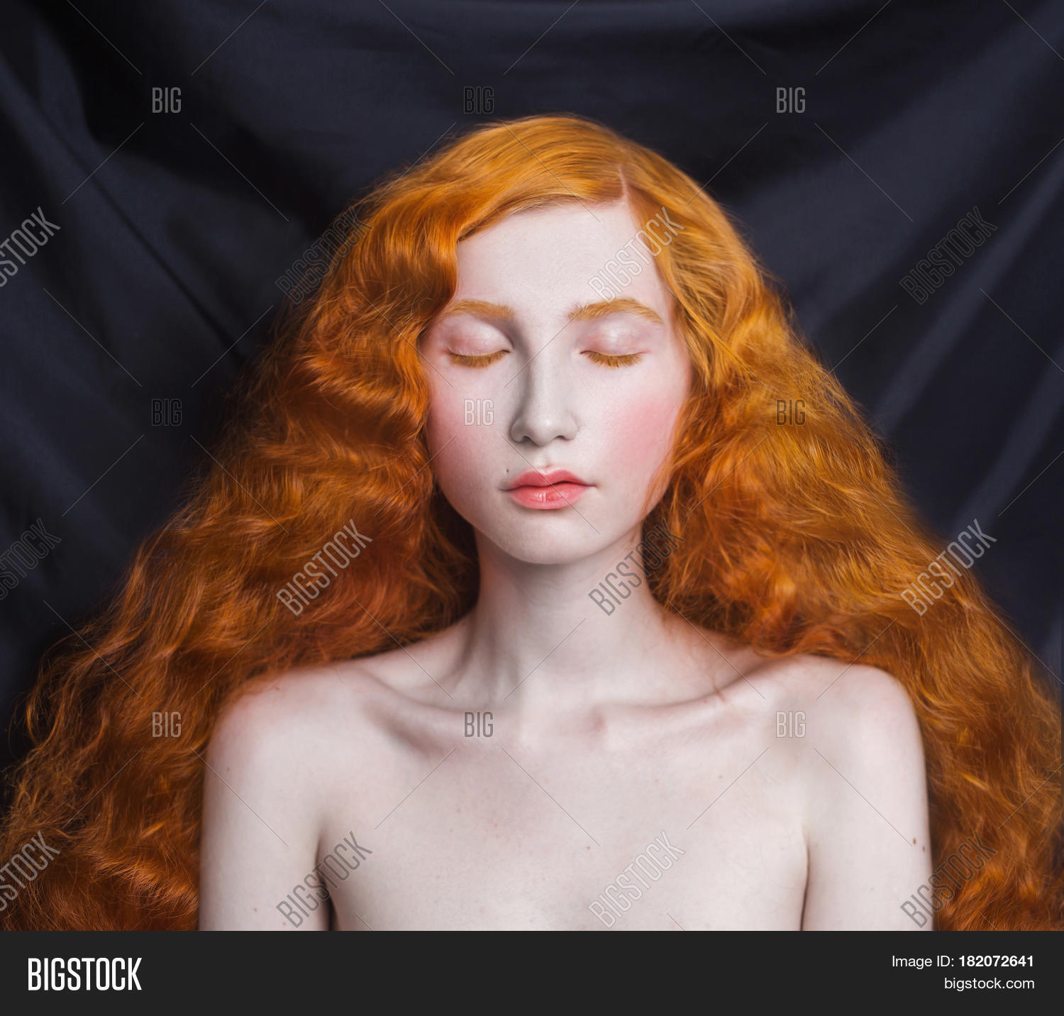 Woman With Long Curly Red Flowing Hair On A Black Background Girl