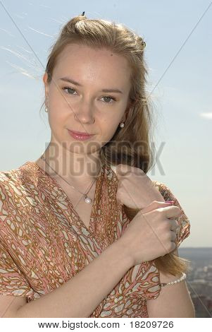 Girl holding a lock of  hair