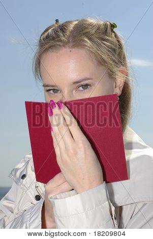Girl covered a red book