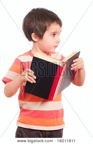 Little Boy Looks Aside While Reading Book