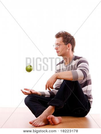 Young man Holding Green Apple