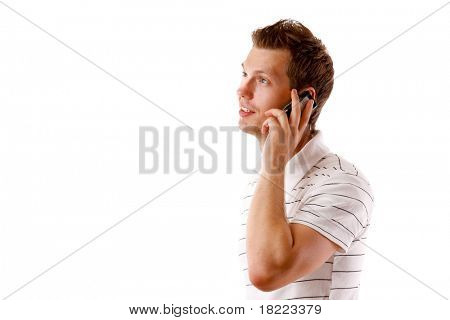 Closeup portrait of a happy young guy speaking on cellphone