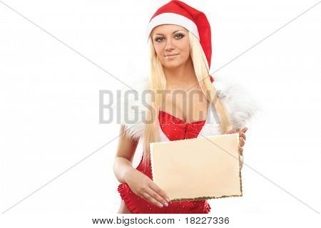 Girl in Santa peeking over paper sign board looking up. Cute funny photo closeup of christmas woman with copyspace. Isolated on white background