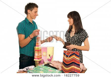 Portrait of woman holding color shopping bags