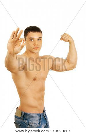 man holding two pills isolated on white background