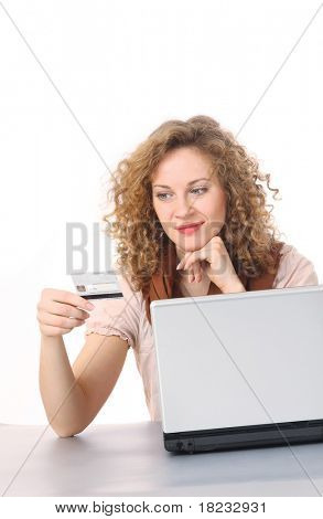 Girl using a card to shop safely online isolated on white backgroun