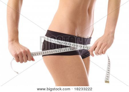 woman measure her waist belly by metre-stick. More images of this models you can find in my portfolio
