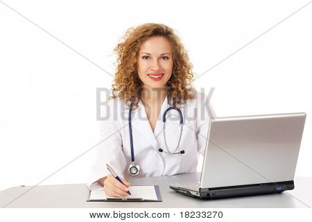Beautiful young doctor working in front of laptop isolated over white background