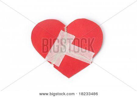Corazón rojo con esparadrapo