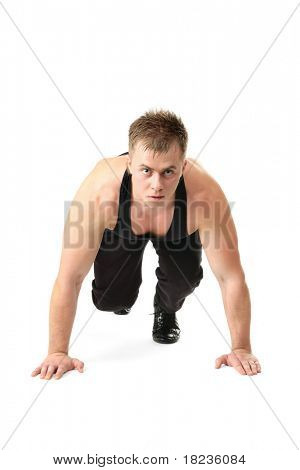 Full length portrait of an athlete ready to run, ooking at camera, isolated on white background