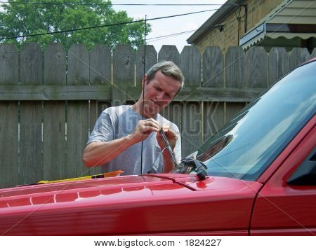 Man Working On Car