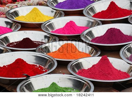 Colored powders at market in Orchha, India