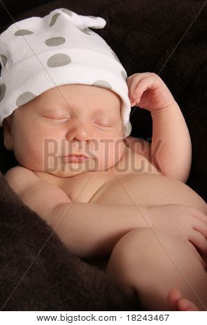 Newborn baby boy wearing a hat.