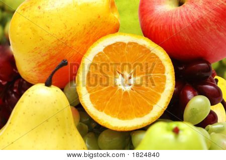Half Cut Orange And Other Colourful Fruits