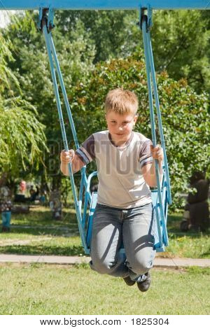 Little Boy On A Swing