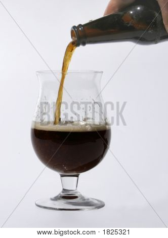 Pouring Dark Beer Into Glass
