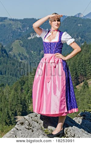 Bavarian girl on the mountain top