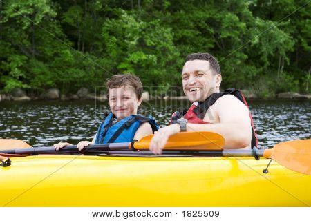 Father And Son Enjoying Kayaking