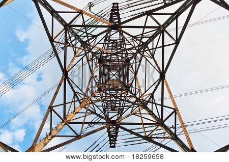 Angle View Of A Power Line With Clouds In The Background