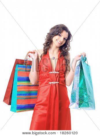 Retrato de una joven sosteniendo varios shoppingbag