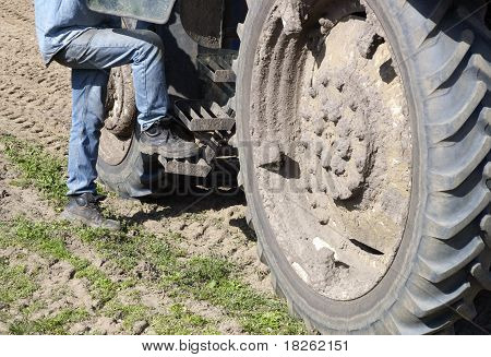 Farmer Gets On His Tractor