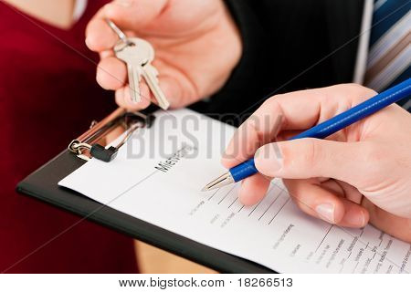 Rent an apartment - Signing tenant agreement; close-up on form