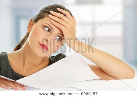 Overworked businesswoman isolated on white background