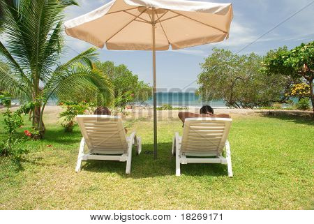 Couple relaxes at beach in Costa Rica
