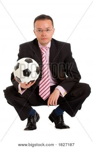 Business Man And A Football