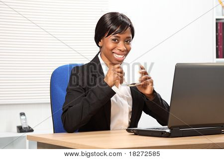 Beautiful Black Woman Drinks Coffee At Work