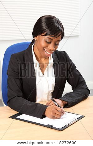 Beautiful Black Business Woman Signing Document