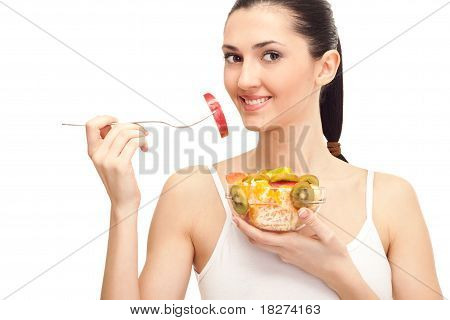 Young Lady Eating Fruit Salad