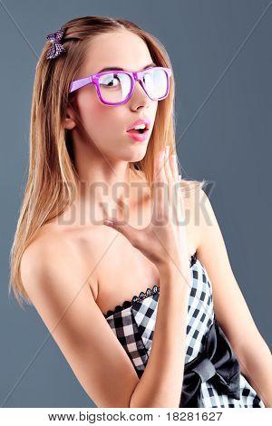 Portrait of a beautiful girl in a light summer dress.