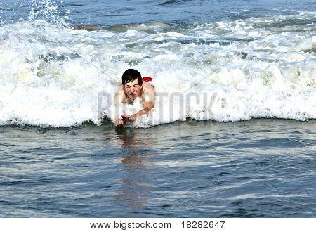 boy enjoys the waves in the ocean