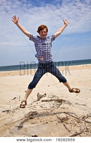 boy enjoys  the beautiful beach and jumps