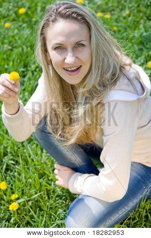 Young beautiful a woman in spring field