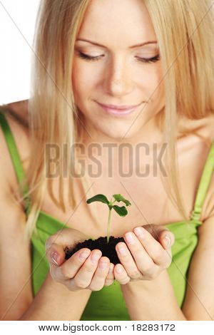 plant in blonde hands