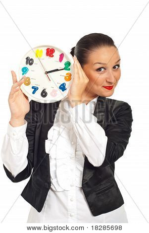 Business Woman Smiling Behing Clock