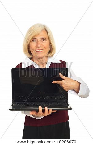 Senior Woman Pointing To Laptop Screen