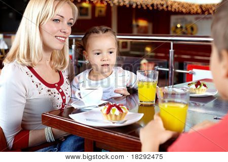 Portrait of happy family having lunch in cafe