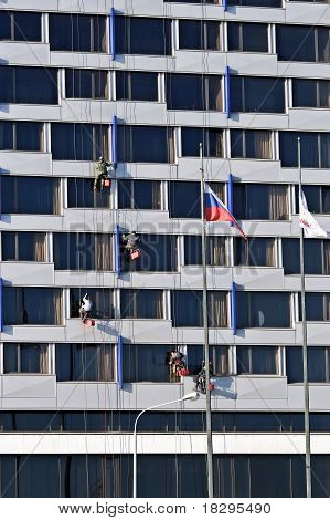 Windows cleaners on office building