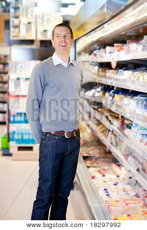 Portrait of a happy smiling customer in a grocery store